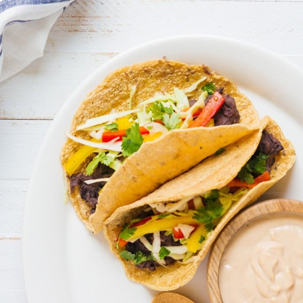 Refried Bean Tacos with Chipotle Cashew Cream [vegan] by A Couple Cooks